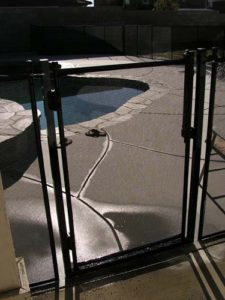 Black mesh pool gate installed in Chula Vista